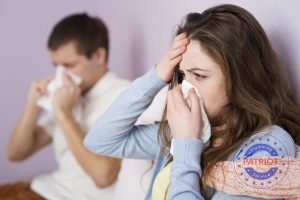 Man and Women Display Symptoms of the Flu