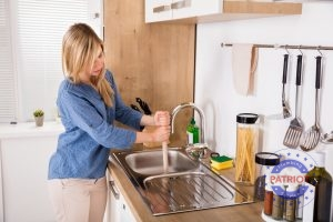 Woman Plunges the Sink After a Clog Forms