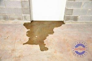 A Nasty Water Leak Flows Beneath the Door